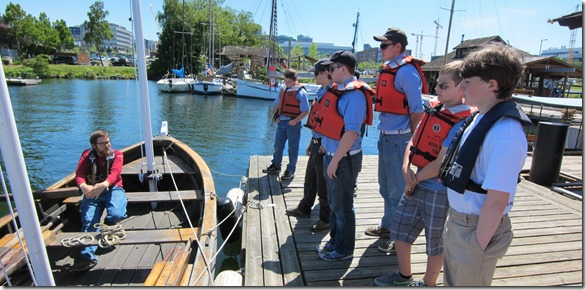 Tyson helps the Sea Scouts learn longboat